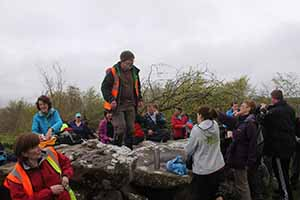 Historian Seamus Ó hUltacháin giving a talk at Giant's Grave passage tomb in the Cavan Burren, one of 30 events during This is Cavan Walking festival May 2-11 2014.