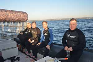 Preparing for a Shark Cage dive at Rocky Bay beach in KwaZulu Natal during Indaba 2013, Emma Gregg African specialist travel writer, Eoghan Corry editor of Travel Extra, Patrick Welch of The Metro, and Ian Mallory travel blogger