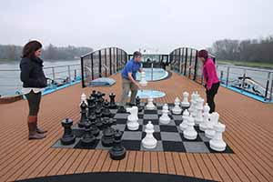Lorraine Kenny of Ask Susan watches Eoghan Corry of Travel Extra and Marie Claire Porter of Sunway play chess on board AmaCerto on the Rhine, Nov 26 2014
