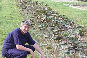 Irish travel writer Eoghan Corry of Travel Extra with lotus plants at Dr Prasert's Organic Agriculture Project, Sukhothai Airport on the pre-fam prior to Thailand Travel Market, Monday June 3 2013