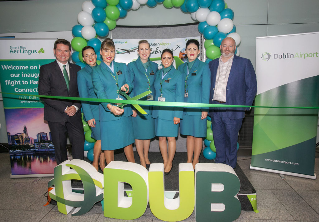 Aer Lingus Cabin Crew with Declan Kearney, Director of Communications, Aer Lingus (far left) and Paul O'Kane, Chief Communications Officer, DAA (far right) at the gate reception to celebrate Aer Lingus' inaugural flight to Hartford Connecticut which took to the skies today from Dublin airport at 2.40pm