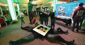 Students Barra O'Siochru, Katie Tobin and Laura Hynes from the Gael Cholaiste in Tralee and classmates take part in the mannequin challenge with 250 other students in the INEC Killarney. Photo: Domnick Walsh © Eye Focus Ltd