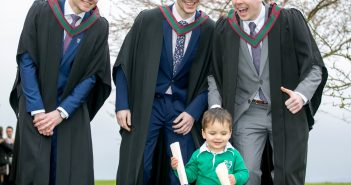 Cian Mahey (2). Cahersiveen Co. Kerry, steals the show and the Scrolls from Kerry graduates Sean Fitzgerald, Ballyferriter, Stephen O'Donoghue, Killarney, and Daragh Kennedy, Annascaul after their graduation in Shannon. Photo: Arthur Ellis.