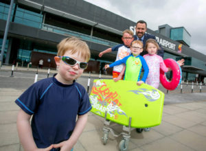 Charlie (8), Neela (5), Alfie (4) and George Harrison (3), from Annacotty, Co Limerick, with Andrew Murphy, Managing Director Shannon Airport. Photo: Arthur Ellis