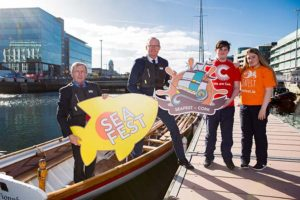 Minister for Agriculture, Food and the Marine Michael Creed and Tánaiste Simon Coveney with students, Myles Ó Raghallaigh, and Cáit Ní Drisceoil, Coláise Dáibhéid, to announce that Cork will host the national maritime festival, Seafest, from 2019 – 2021. Photo: Michael O'Sullivan /OSM PHOTO