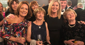 Stephanie Frame and Mary McKenna celebrate Mary's Entrepreneur award with Evelyn and Mary McKenna, sisters of the Tour America MD's late father. Back row, Mary's sister Geraldine Saunders, who is Tour America's HR manage,r and Sue Quinn, a former Tour America GM who has set up her own business, plus brother in law Patrick Quinn, formerly Mary's Financial Controller.