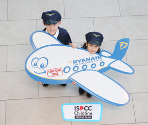 Philip Stafford (10) and Sarah Han Keogh (5), both from Scoil an Duinnínigh, Drynam, Swords, at the Ryanair name a plane launch. Photo: Leon Farrell/Photocall Ireland