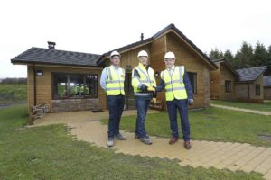 Rapid-build home manufacturer FastHouse announced the completion of its contract to provide and erect the timber frames for 466 lodges at Center Parcs in Longford. Pictured are Sisk Senior Contracts Manager Cormac Fitzpatrick, Center Parcs Construction and Development Director Paul Kent and FastHouse Sales and Installations Director Sean Fox. Photo: Conor McCabe Photography.